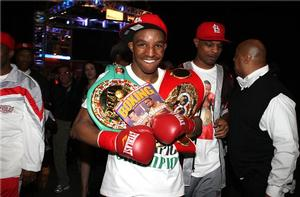 Devon Alexander displays both belts