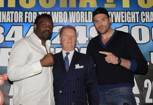 Promoter Frank Warren stands between Chisora and Fury