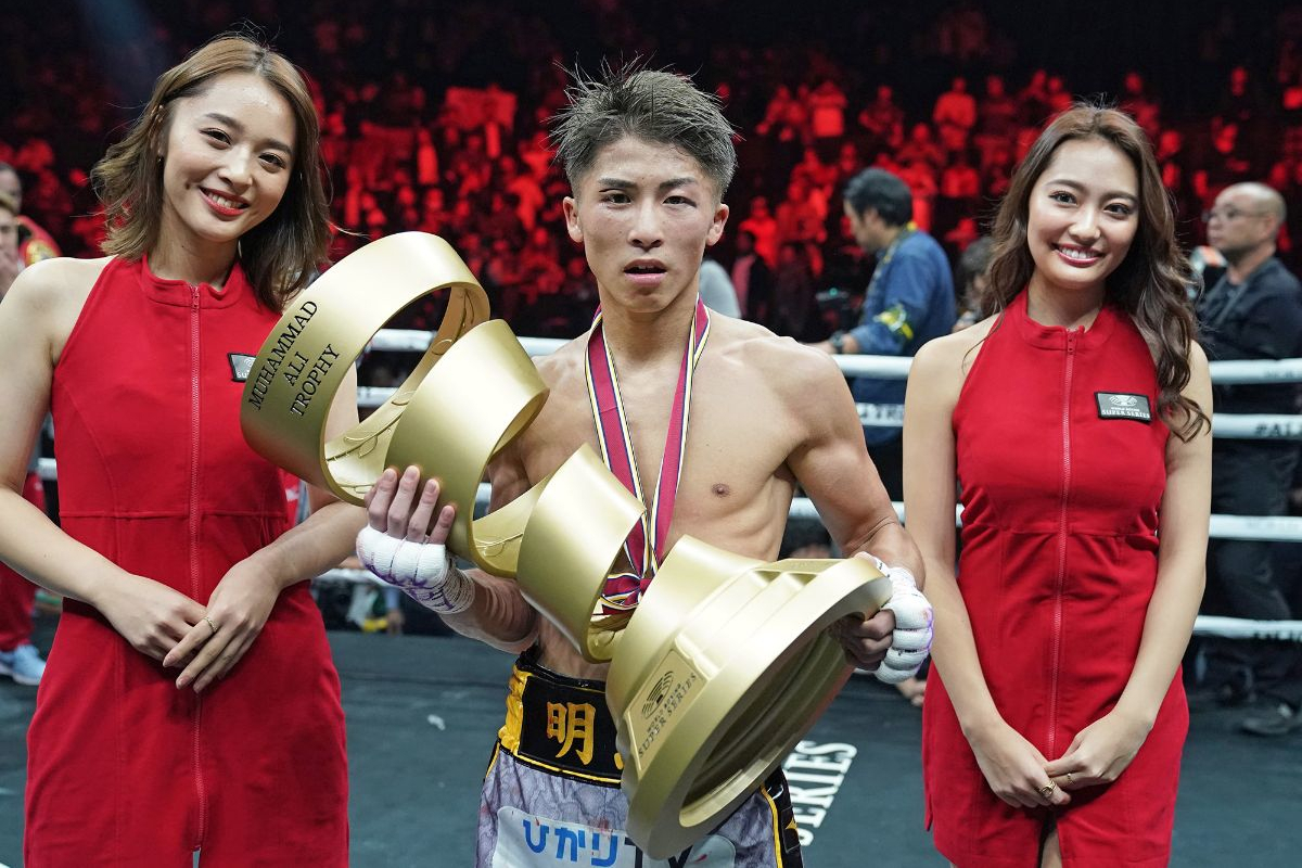 Naoya Inoue with the trophy he would loan to Nonito Donaire