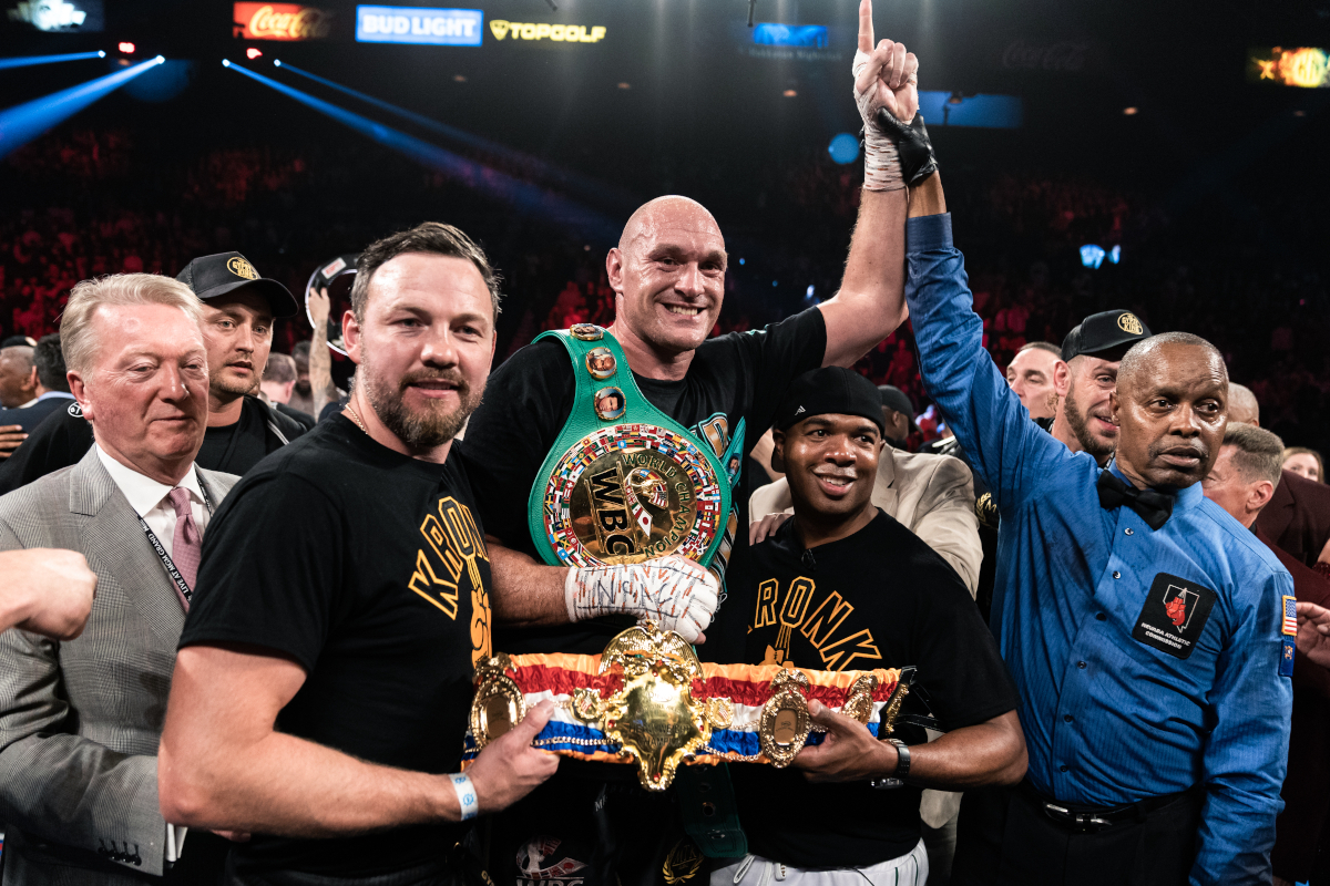 Tyson Fury celebrates beating Deontay Wilder, with SugarHill Steward to his left (Ryan Hafey/PBC)
